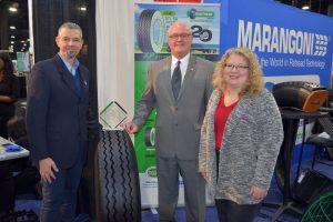 Giampaolo Brioschi, left, Marangoni Group R&D director, and Bill Sweatman, president of Marangoni Tread North America, received a Top 20 Products Award from Deborah Lockridge, editor of HDT.